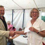 Joyce Lyall collects the First Prize sponsorship award for her Honey Cherry Cake