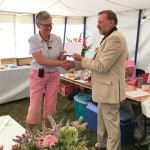 Carole Brown collects First Prize for her bee photograph ... and awards Richard Norman, DBKA president with the FW Carter Challenge Cup!